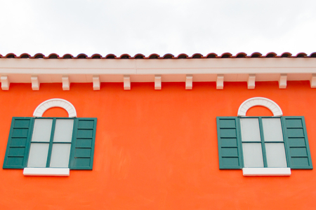 Green window on orange wall photo