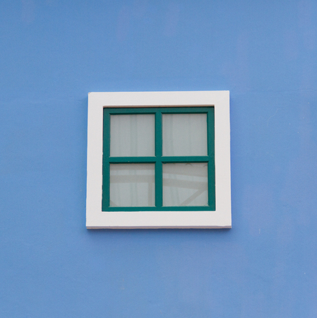 Green window on the blue wall photo
