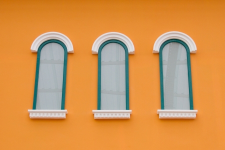 Window on the orange wall Stock Photo - 22255581
