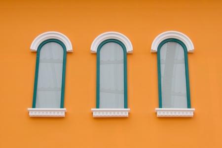 Window on the orange wall Stock Photo - 22255581