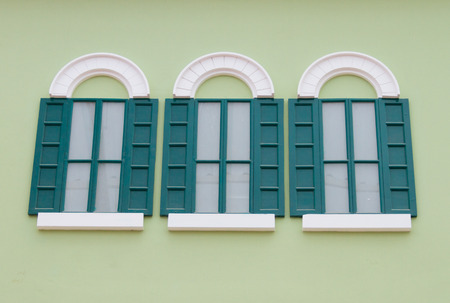 Window on the green wall photo