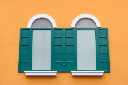 Window on the orange wall Stock Photo - 22255585