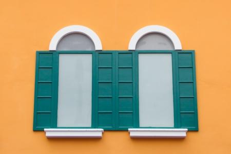 Window on the orange wall Stock Photo - 22255585