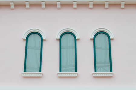 green windows on the pink walls photo