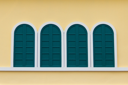 White window on a yellow wall Stock Photo - 22255600