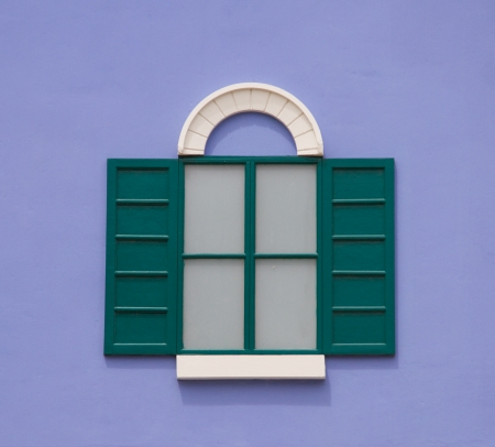 White window on a purple wall photo