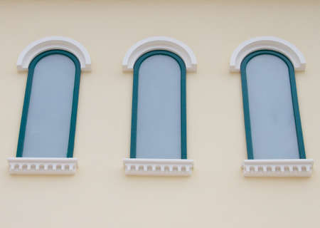 White window on a yellow wall photo