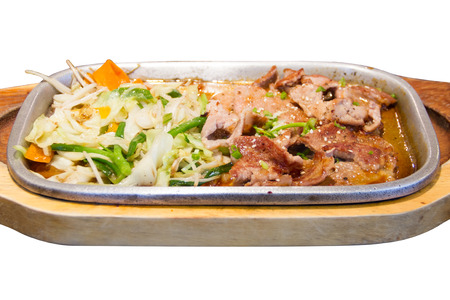 Pork on a hot plate on white background photo