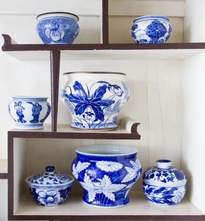 Ancient porcelain bowl placed on the shelves photo