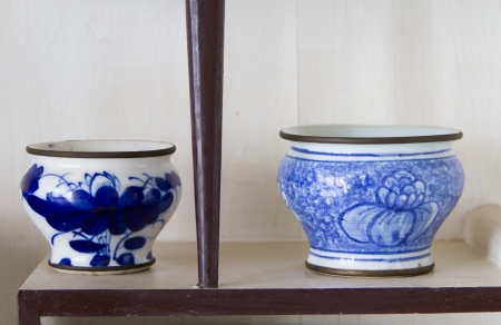 Ancient porcelain bowl placed on the shelves photo