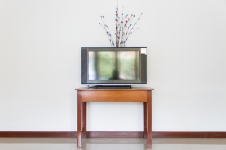 television place on wooden table photo