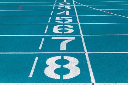 Starting line of blue running track photo