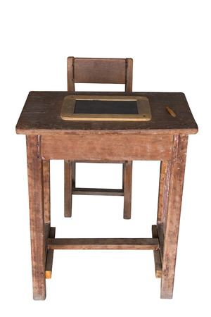 wooden student desk and chair with slate on white background photo