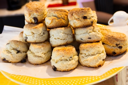 Stack scones on a yellow plate photo