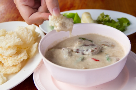 coconut crab: Rice cracker and crab stew Stock Photo