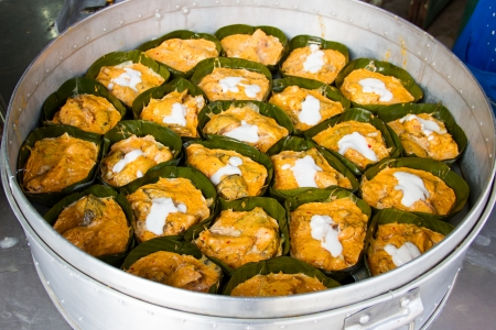 steamed fish with curry paste on banana leaf Stock Photo