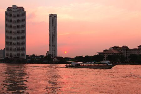 Chao Phraya River at twilight and Passenger ships photo