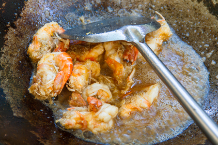 Shrimp fried in a pan photo