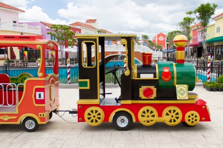 playground ride: carnival train at amusement park