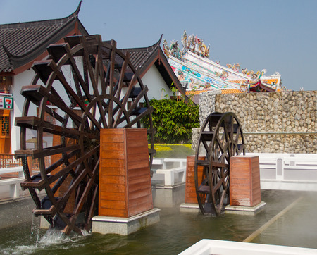 twin house: twin water turbine  in a Chinese village Stock Photo