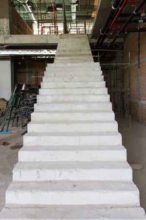 Stairs in a building under construction photo
