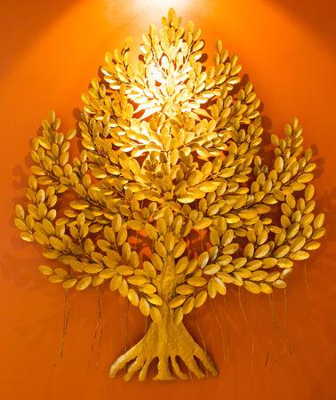 golden tree on orange background photo