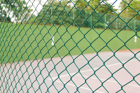 Wire fence at tennis court photo