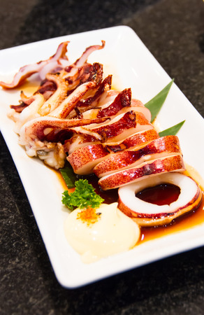 Squid teriyaki grill on white dish