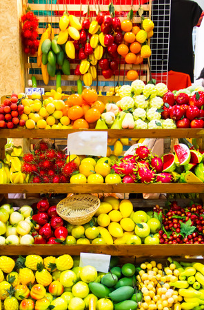 Fake vegetables and fruits on shelves photo