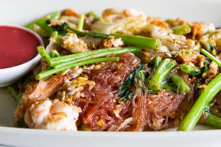 Dry sukiyaki  fried vermicelli with cabbage and pork photo