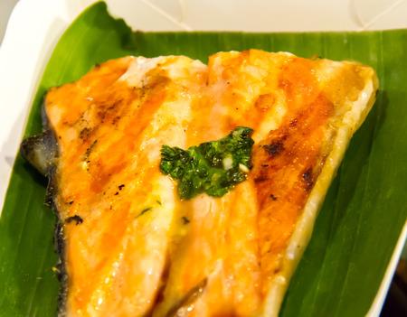 Grilled Salmon on banana leaf photo