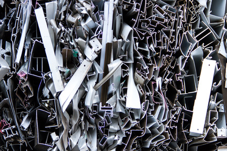 Piles of scrap metal bundled in bales for recycling photo