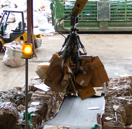 Industrial claw in recycle paper junkyard for recycling