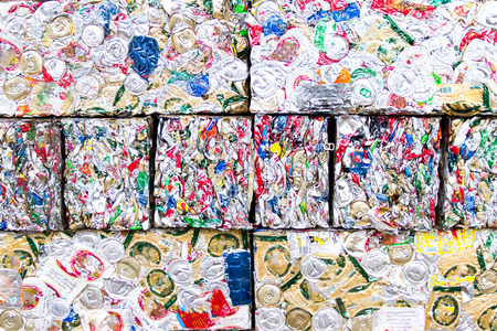 compacted: Small bales of compacted cans for recycling