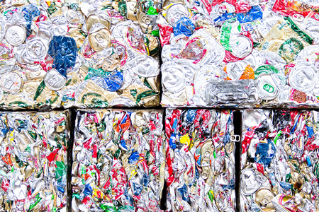 crushed cans: Small bales of compacted cans for recycling