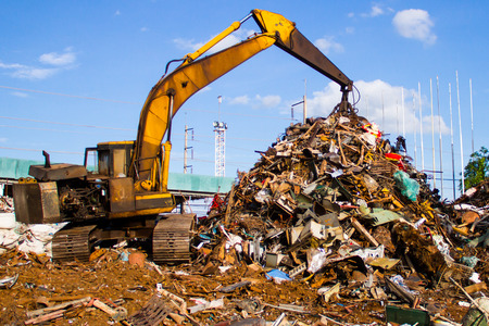 Scrap metal recycling plant and crane-Loading scrap in a truck