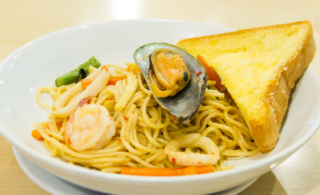 Spaghetti seafood on white bowl photo