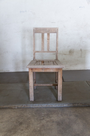 finite: Old wooden chair in a warehouse