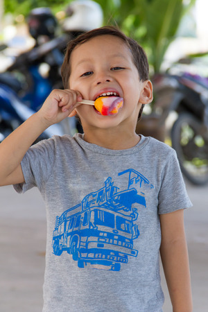 Boy happiness with eating ice cream