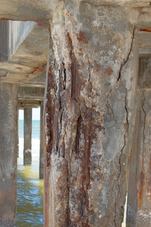 wood pillars: reinforced concrete bridge columns are rusty in the sea
