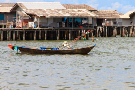 houses on water: Local fishing boats and fishing village background