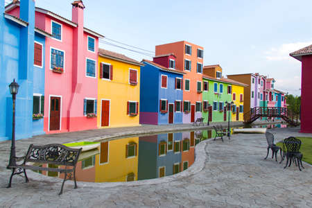 multifamily: colorful townhouse and the pond