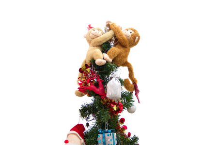 atop: monkeys dolls hugging each other atop the Christmas tree