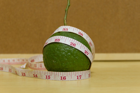 bitter orange: Sour orange, Bitter orange or Seville orange and measuring tape Stock Photo