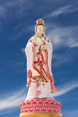 Statue of Guanyin and blue sky Stock Photo