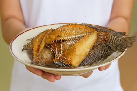 Fried gourami on a plate Stock Photo