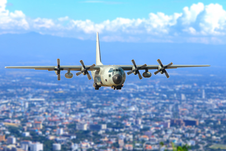 Military transport aircraft in the sky Stock Photo