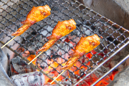 marinade: Chicken wings on the grill charcoal