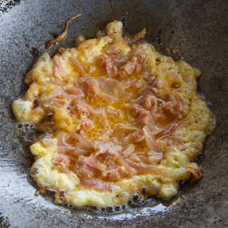plates of food: Omelette sour pork in pan