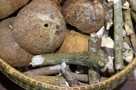 wood carvings: Coconut shells and firewood in the basket